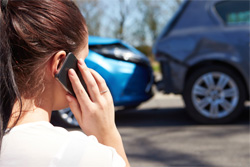 Woman phone in front of car accident